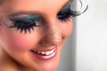 10880132-closeup-of-a-pretty-girl-with-extreme-makeup