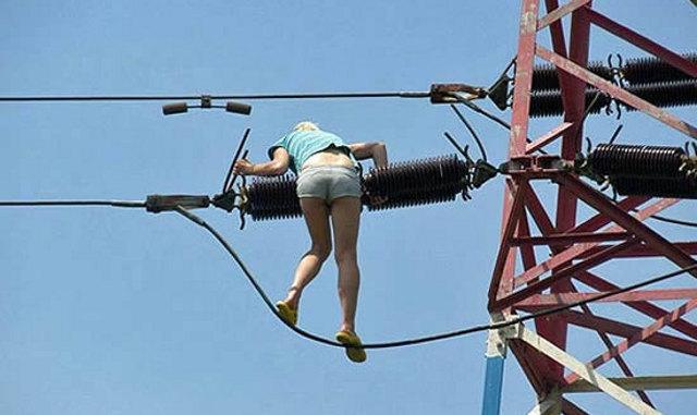 High Girl on a power line