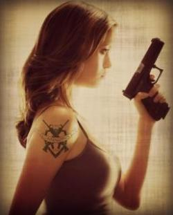 girl with tatto and gun