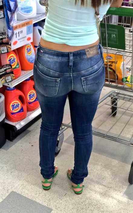 Woman showing asses in tight jeans